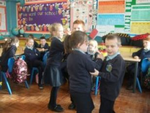 Children from P3/4 learning to Irish Dance