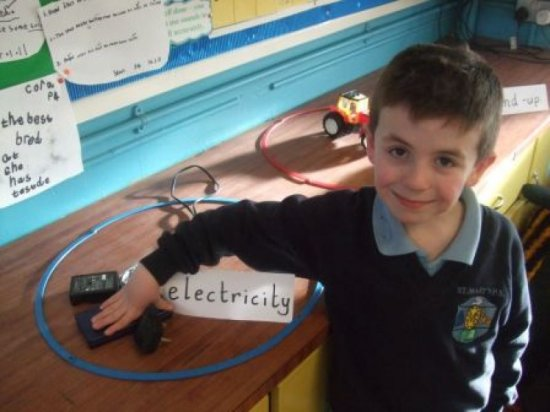 child with electricity toy